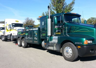 unit1-towing-3-new-trucks-to-dealer
